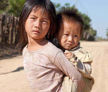 girl carrying brother